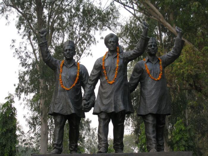 1200px-Statues_of_Bhagat_Singh,_Rajguru_and_Sukhdev-1507272763.jpg